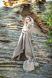 Beautiful young woman standing in ancient dress Royalty Free Stock Photos