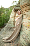 Beautiful young woman standing in ancient dress stock photo
