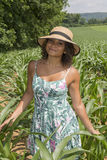 Beautiful young woman standing in corn field - rural summer Stock Photos