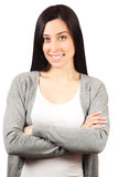 Young woman standing with hands folded Royalty Free Stock Image