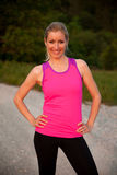 Beautiful young woman standing happy smiling after runn on a mountian path Royalty Free Stock Photo