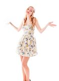 Beautiful young woman standing with her arm outstretched Royalty Free Stock Images