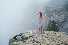 Beautiful young woman standing on a hillside, beauty Stock Photos