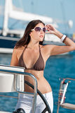 Beautiful young woman standing on luxury boat Royalty Free Stock Image