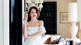 Beautiful young woman standing near the door in the light luxury Royalty Free Stock Photo