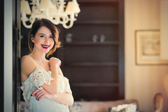 beautiful young woman standing near the door in the luxury Royalty Free Stock Photo