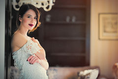 beautiful young woman standing near the door in the luxury Royalty Free Stock Photos