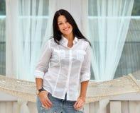 Beautiful young woman standing near window  young Stock Photos