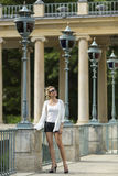 Beautiful young woman standing in the Royal Baths Park in Warsaw Royalty Free Stock Images
