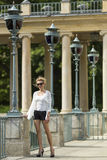 Beautiful young woman standing in the Royal Baths Park in Warsaw, Poland. Stock Image