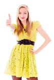 Beautiful young woman standing and showing thumbs up sign Stock Photography