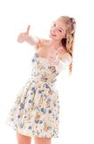Beautiful young woman standing and showing thumbs up sign with b Royalty Free Stock Images