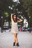 Beautiful young woman standing in a street Stock Photo
