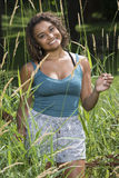 Beautiful young woman standing in tall grass - rural summer Stock Photography
