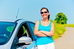 Beautiful young woman stands near the car Royalty Free Stock Photo