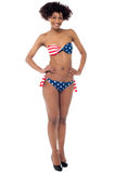 Beautiful young woman in a stars and stripes bikini Stock Images