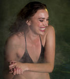Beautiful Young Woman in Steamy Hot Tub Royalty Free Stock Photography