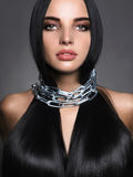 Beautiful young woman in steel chain royalty free stock photo