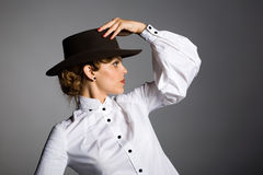 Beautiful young woman in a stetson Royalty Free Stock Images