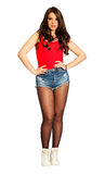 Beautiful young woman straight hair, jeans shorts and red tank top. PNG available. Beautiful and young girl pin up with a red tank top and jeans shorts and Stock Images