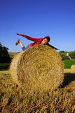 Beautiful young woman on the straw Royalty Free Stock Photography