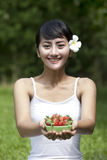 Beautiful young woman with strawberry Royalty Free Stock Images