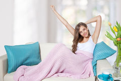 Beautiful young woman streching. Her arms after wake up Royalty Free Stock Photos