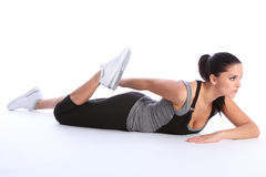Beautiful young woman stretch exercising on floor Stock Photos