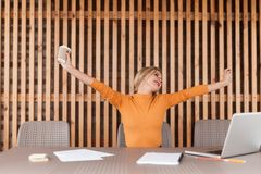 Beautiful young woman stretch in workplace, attractive caucasian businesswoman