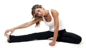 A beautiful young woman stretching Royalty Free Stock Images