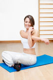 Beautiful young woman stretching the muscles of her in yoga clas Stock Photo
