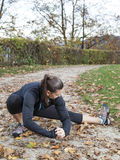 Beautiful young woman stretching in the park Royalty Free Stock Photo
