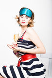 Beautiful young woman in a striped dress holding a glass of champagne Royalty Free Stock Photos