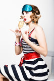Beautiful young woman in a striped dress holding a glass of champagne Royalty Free Stock Image