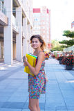 Beautiful young woman, student in a big city Royalty Free Stock Photo