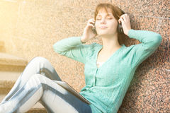 Beautiful young woman student with headphones Stock Photo
