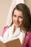 Beautiful young woman student hold book Stock Photography