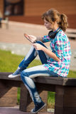 Beautiful young woman student with note pad. Outdoor student. Stock Photography