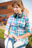 Beautiful young woman student with note pad. Outdoor student. Royalty Free Stock Images