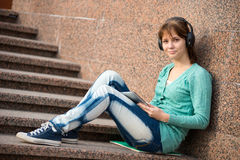Beautiful young woman student with note pad and Stock Photo