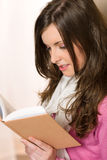 Beautiful young woman student reading book Royalty Free Stock Photo