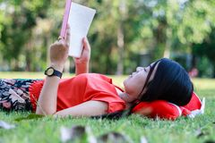 Beautiful young woman-student reading book Royalty Free Stock Photography