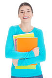 Beautiful young woman student with workbook. Stock Images