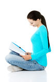 Beautiful young woman student with workbook. Stock Photos