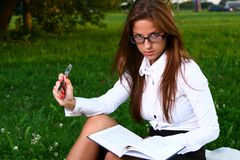 Beautiful young woman studing in park Royalty Free Stock Images