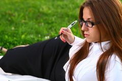Beautiful young woman studing in park Royalty Free Stock Photo