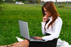 Beautiful young woman studing in park Stock Photos