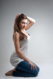 Beautiful Young Woman in Studio on Grey Background Stock Photography