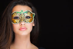 Beautiful Young Woman. Studio portrait wearing a mask on a black background Royalty Free Stock Photography