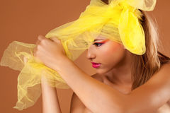 Beautiful young woman in the studio, wearing colorful make up Stock Photo